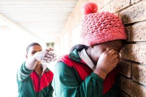 Gang bully pushes school girl