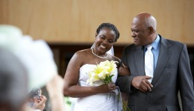 Father walking bride down church aisle