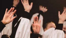 Church Choir's Hands Raised