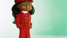 Doll wearing red leisure suit