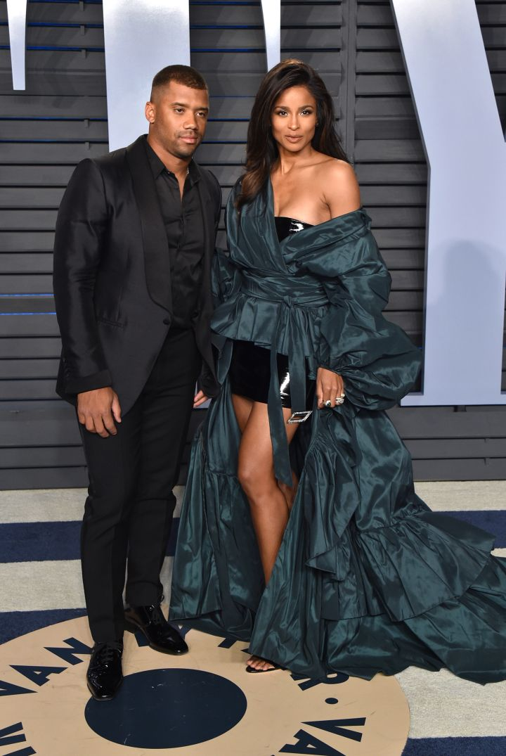 RUSSELL WILSON (L) AND CIARA (R)