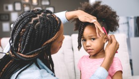 mother styling daugher's hair