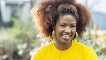 Black woman smiling outdoors