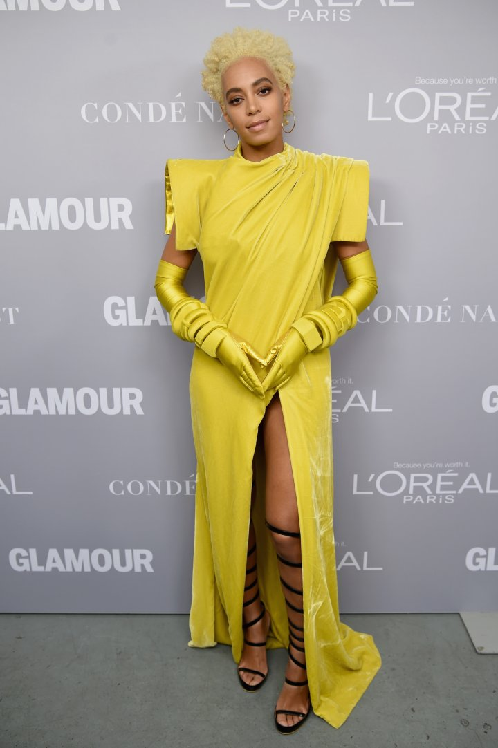 Solange werking the red carpet in a canary yellow high slit dress