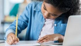 Schoolgirl working on class assignment