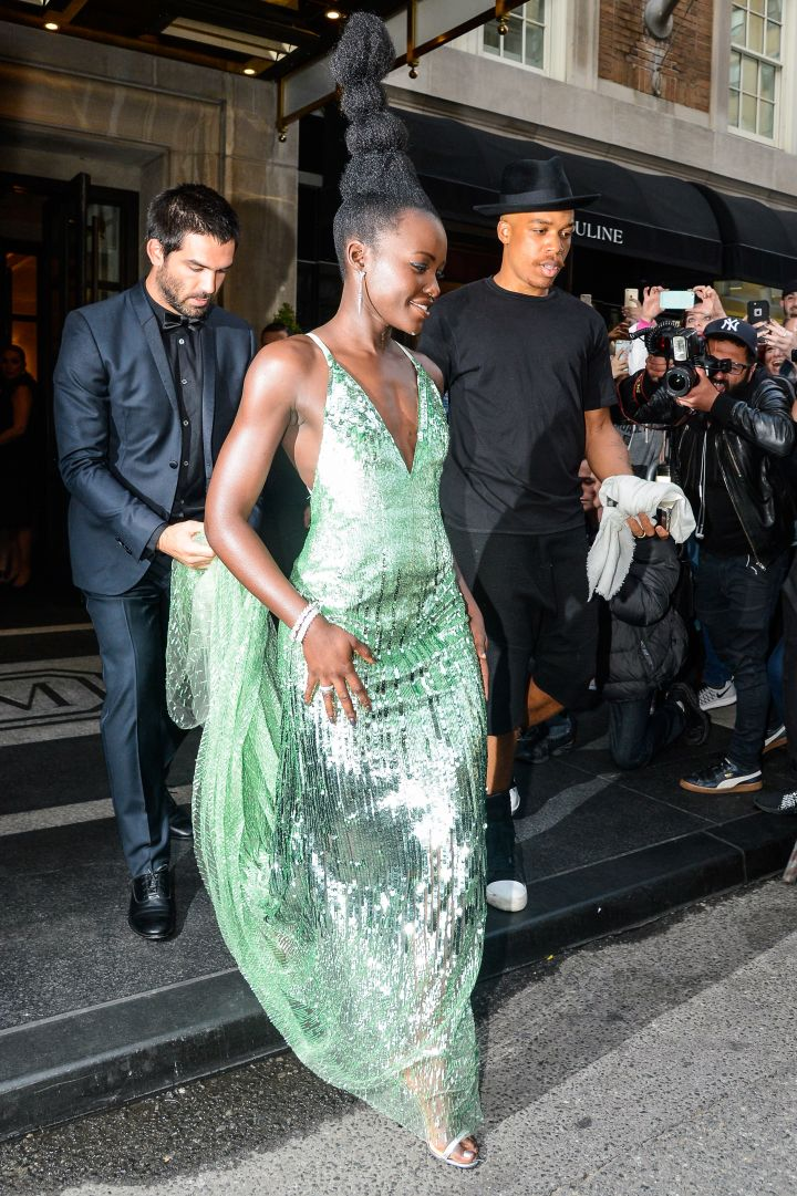 Lupita Nyong'o in a shimmery green dress