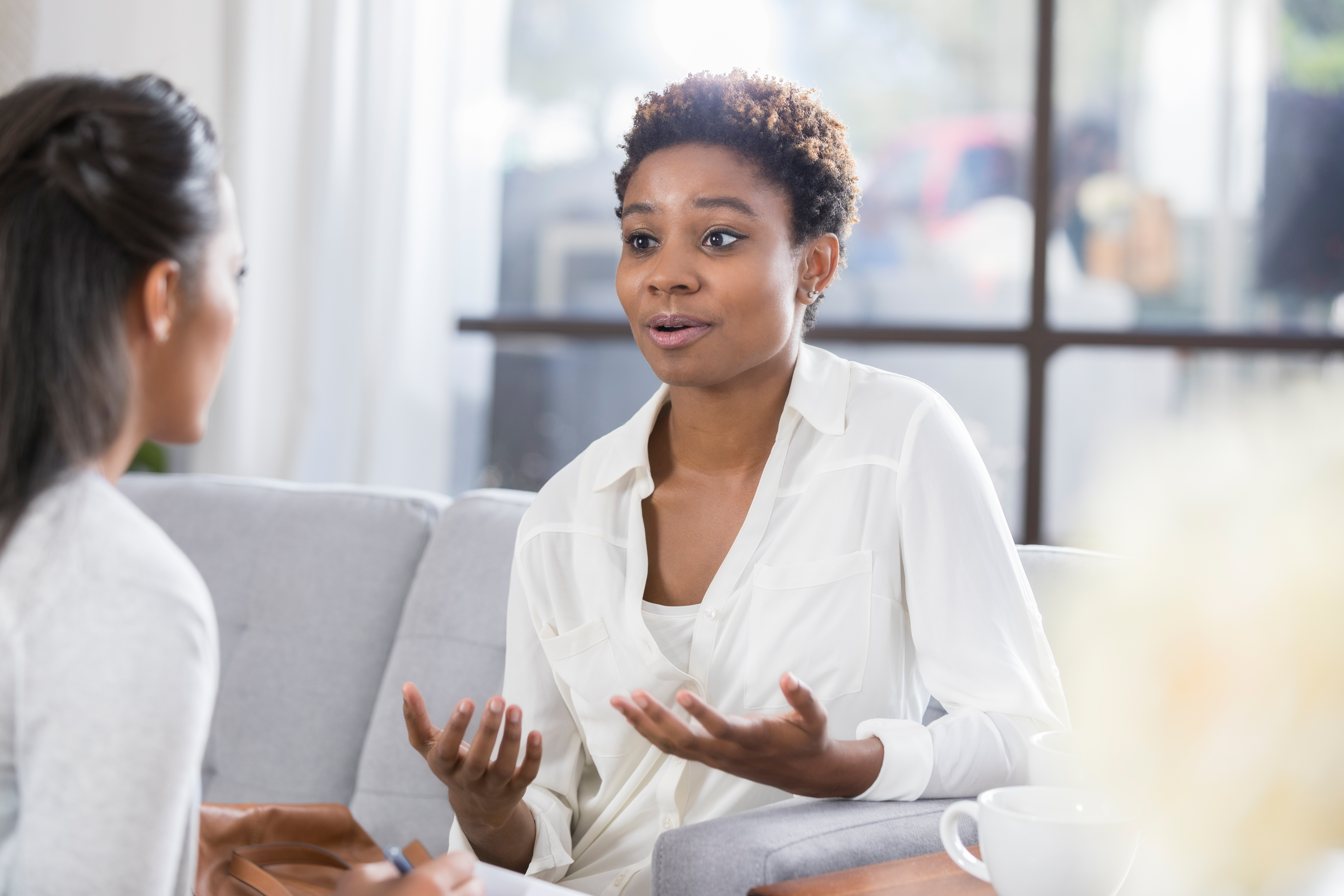 Concerned woman talks with therapist