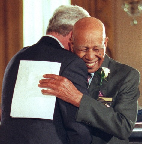 Ninety-four-year-old Herman Shaw(R) embraces US Pr