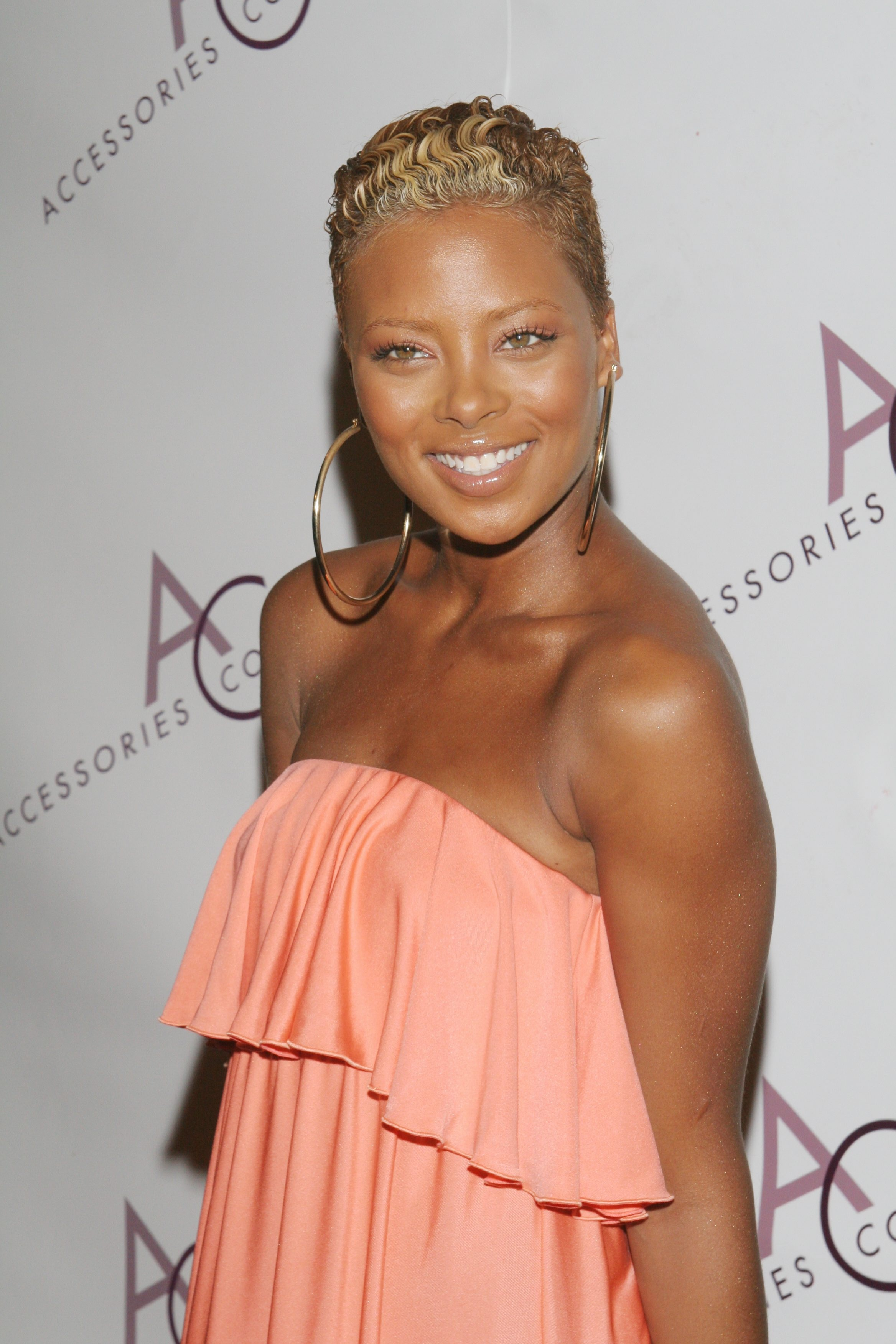 Eva Marcille Wears Nothing But A Wig & Crystal Christian Louboutins