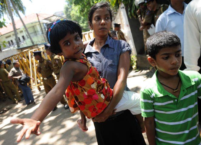 Sanjeewani (C), wife of detained Sri Lan