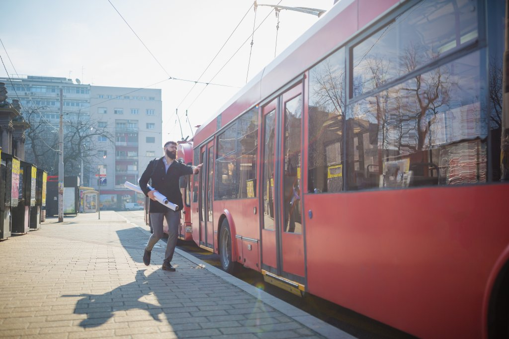 Businessman trying to catch the bus