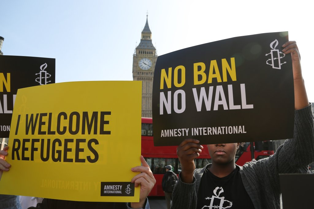 Amnesty International organise Flash Mob protest against Trump's Travel ban