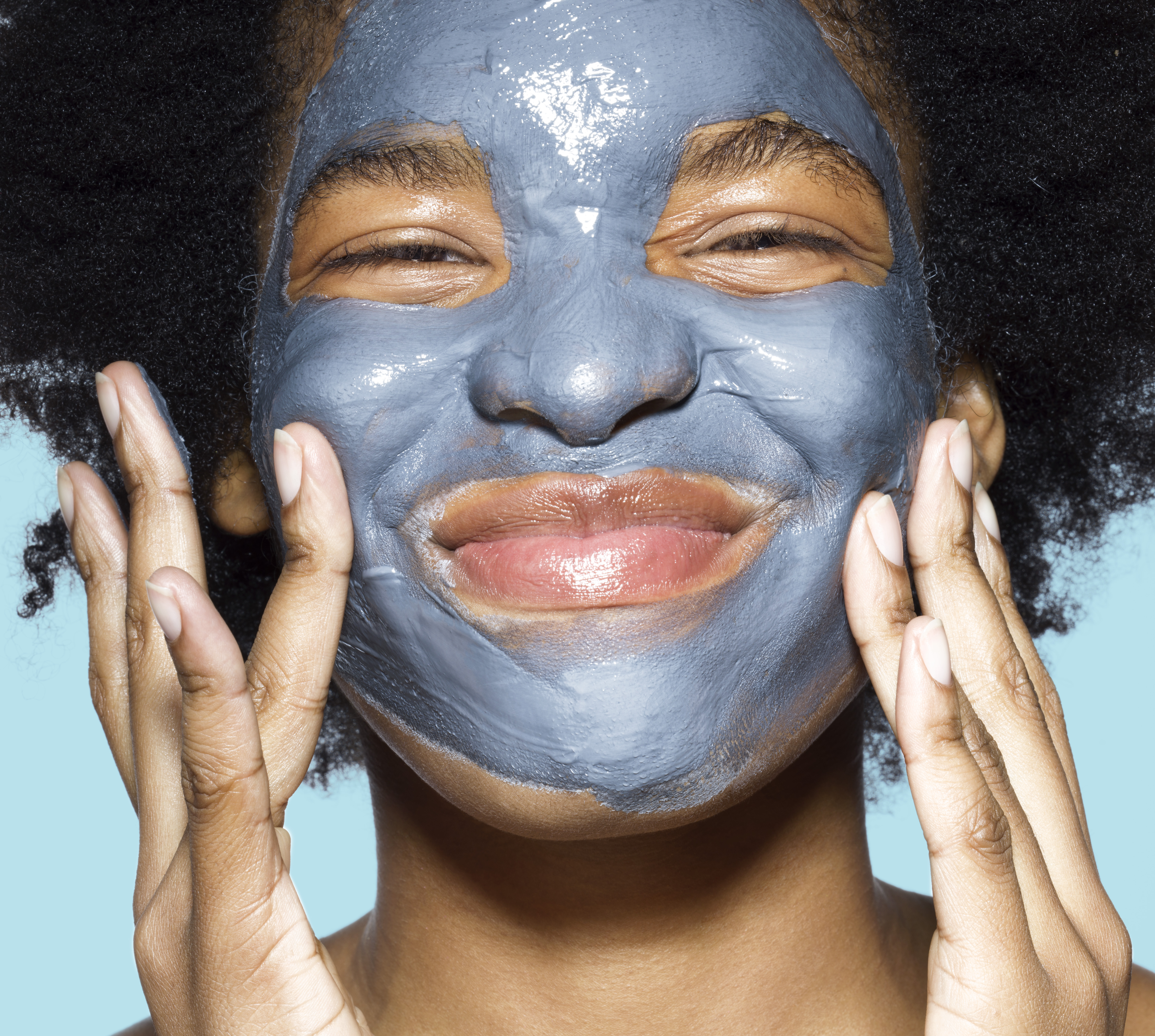 Young female with cleansing mask