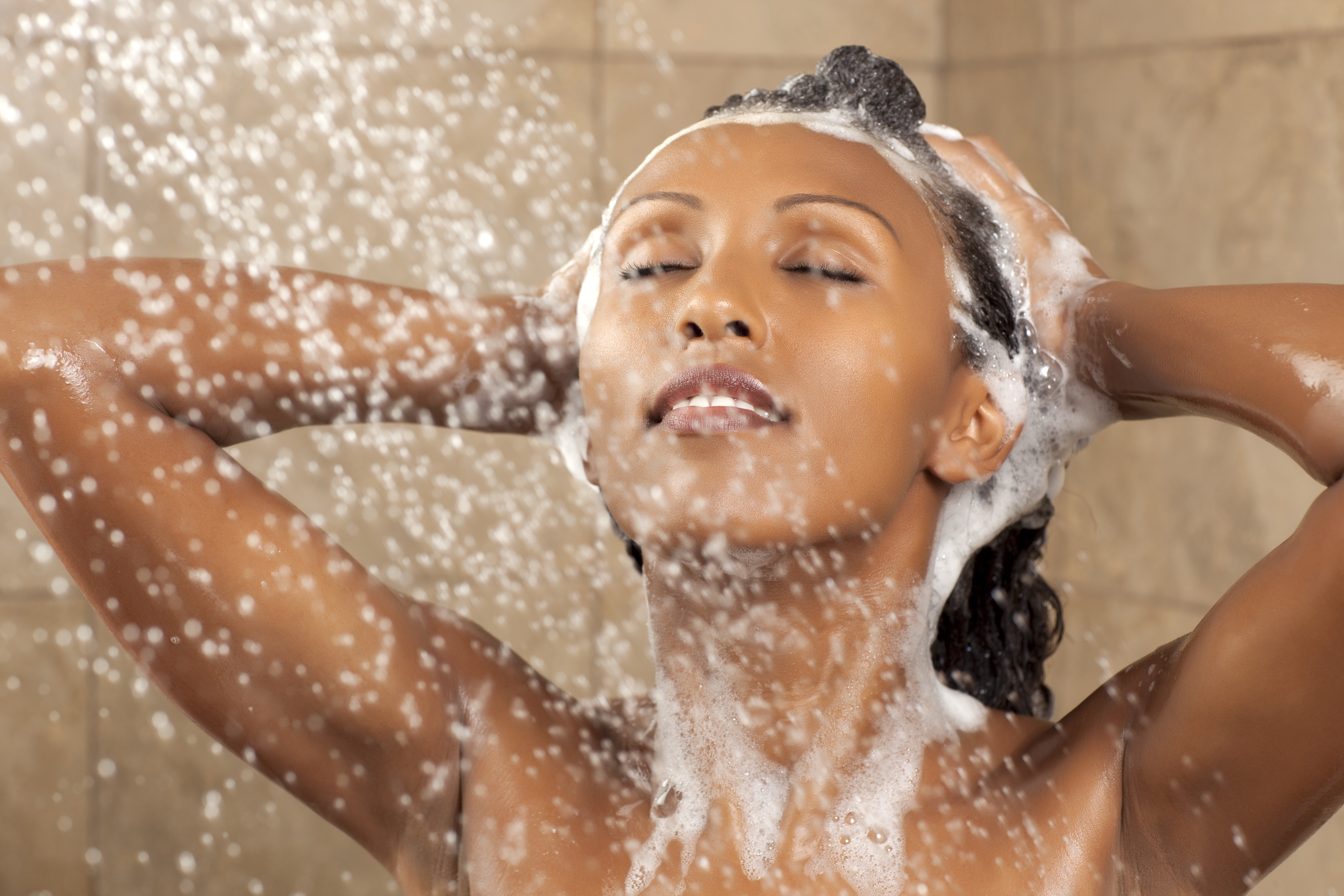 Attractive woman taking shower.