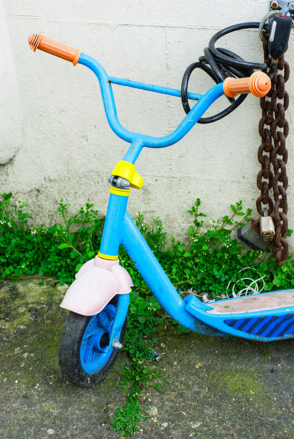 Child s scooter chained to wall