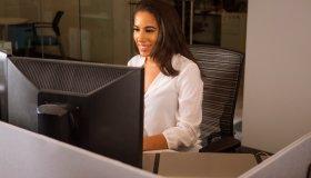 Latina Woman At Desk Side Shot