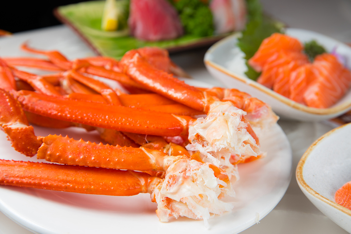 Meal of crab legs on plate