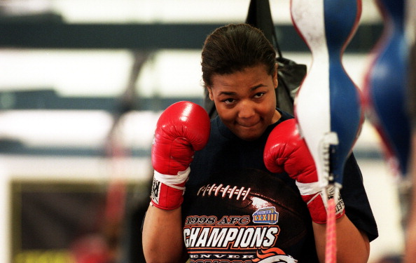 Boxer Freeda Foreman, daughter of former heaveyweight champion George Foreman, warms up during a training session at America Presents Gym in Denver.