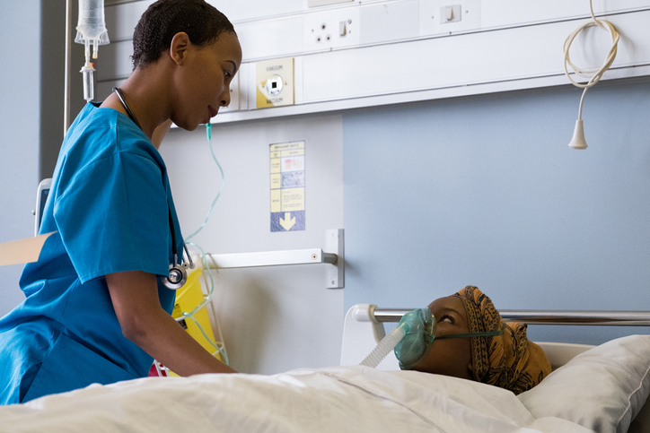 African doctor attends to her patient