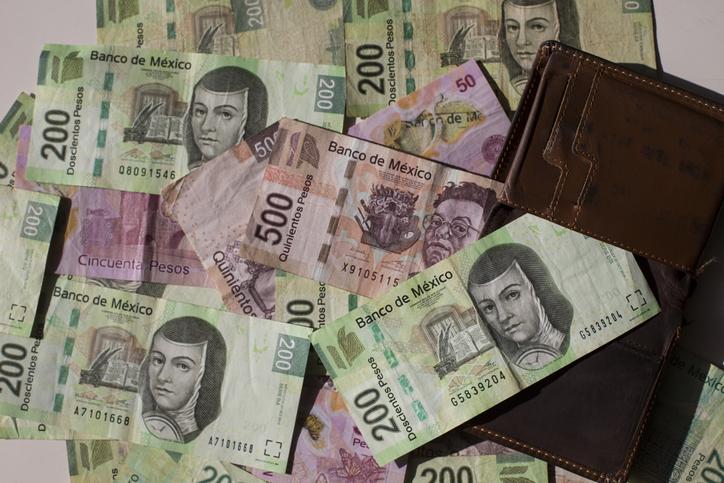 Mexican pesos and wallet