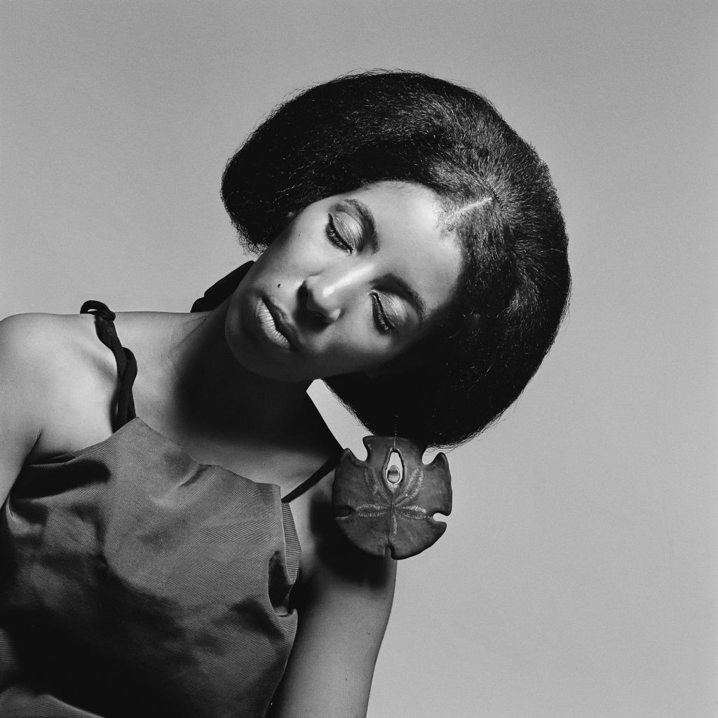 Kwame Brathwaite, Carolee Prince wearing her own jewelry designs. Prince created much of the jewelry and headpieces featured in Brathwaite's work. African Jazz-Art Society & Studios (AJASS), Harlem, ca. 1964; from Kwame Brathwaite: Black Is Beautiful (Aper
