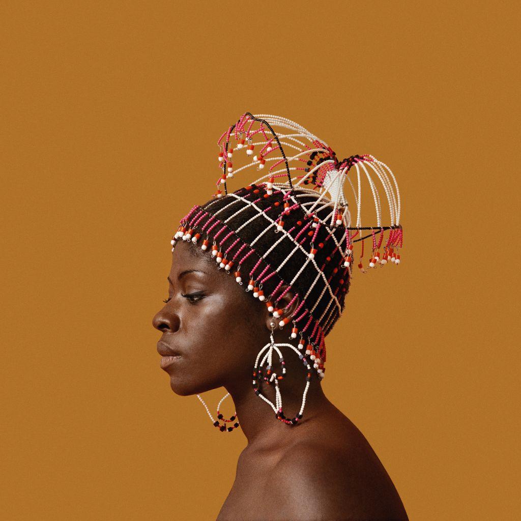 Kwame Brathwaite, Sikolo Brathwaite wearing a headpiece designed by Carolee Prince, African Jazz-Art Society & Studios (AJASS), Harlem, ca. 1968; from Kwame Brathwaite: Black Is Beautiful (Aperture, 2019)
