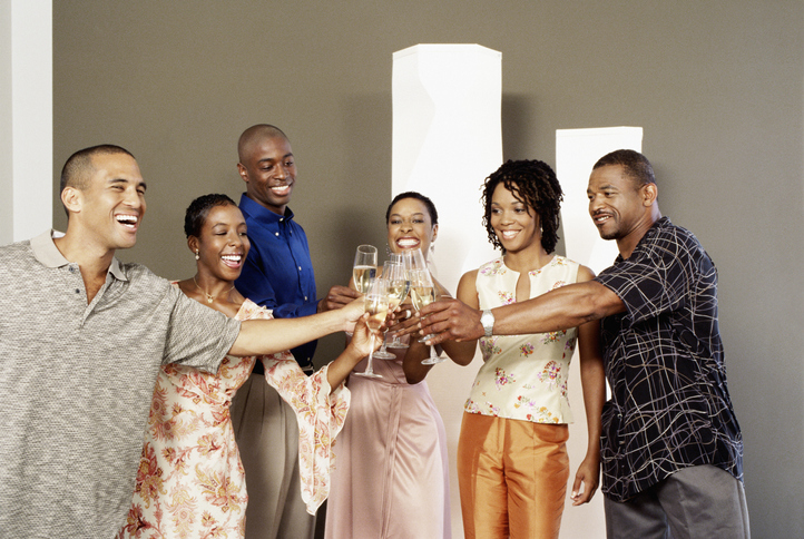 Group Toasting Champagne at a Party