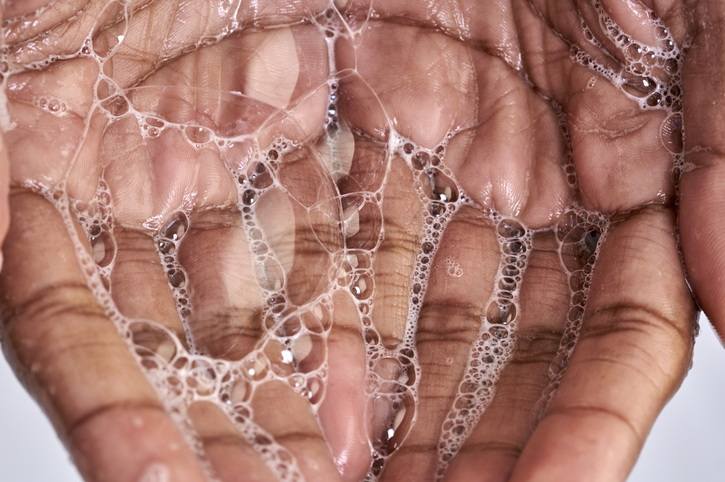 Close up of a black woman hand with soap
