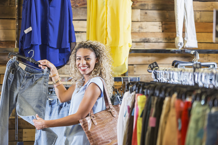 Young mixed race woman shopping for clothing