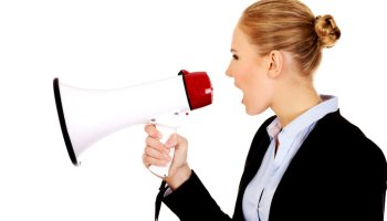 Side View Of Businesswoman Shouting On Megaphone Against White Background