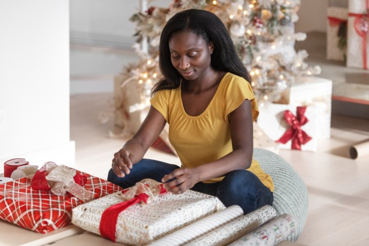 African woman wrapping gifts
