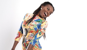 Full Length Of Smiling Woman Standing Against White Background
