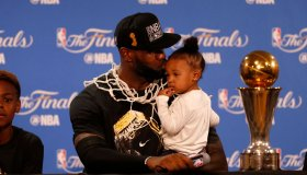 Cleveland Cavaliers' LeBron James (23) gives his daughter Zhuri Nova James a kiss during a press conference after the Cavaliers beat the Golden State Warriors in Game 7 93-89 for the NBA Finals at Oracle Arena in Oakland, Calif., on Sunday, June 19, 2016.