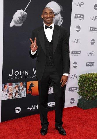 kobe bryant black and white suit red carpet