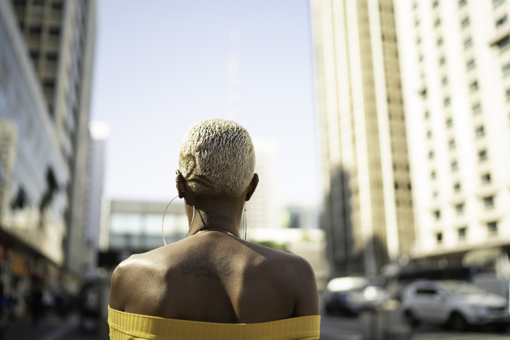 Rear view of a woman walking in the city