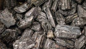 LONDON, UK - APRIL 15, 2019: Collection of black tourmaline semi precious stones and minerals.