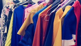 Clothes Hanging On Rack In Store For Sale