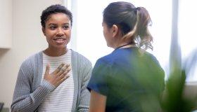 Nurse explaining good news to female patient