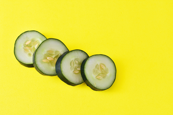 Sliced Cucumber Of Spain On Yellow Background