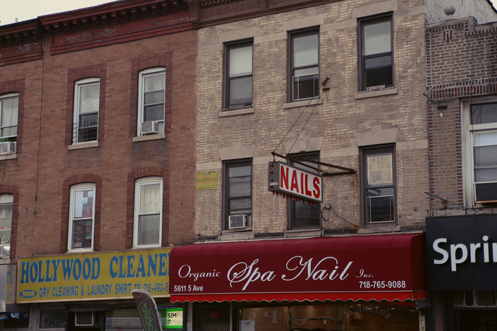 Store signs and canopies in the district of Sunset Park, in Brooklyn, New York City
