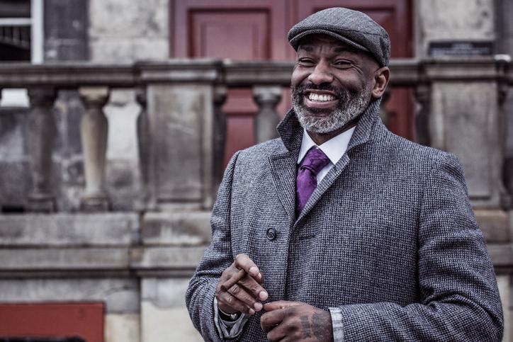 Portrait of a black vintage Gangster Man in an old city