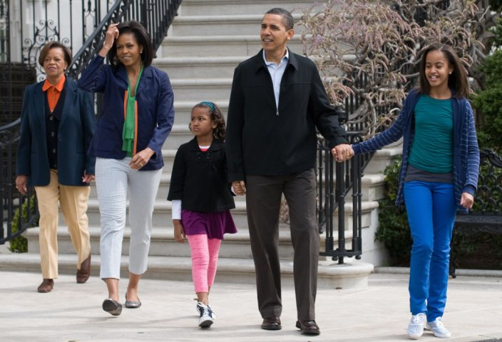 US President Barack Obama walks alongsid