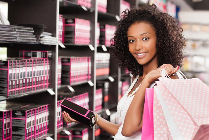 Beautiful young woman shopping cosmetics.