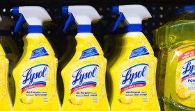 Lysol bottles on a store shelf, plastic spray bottles of all...