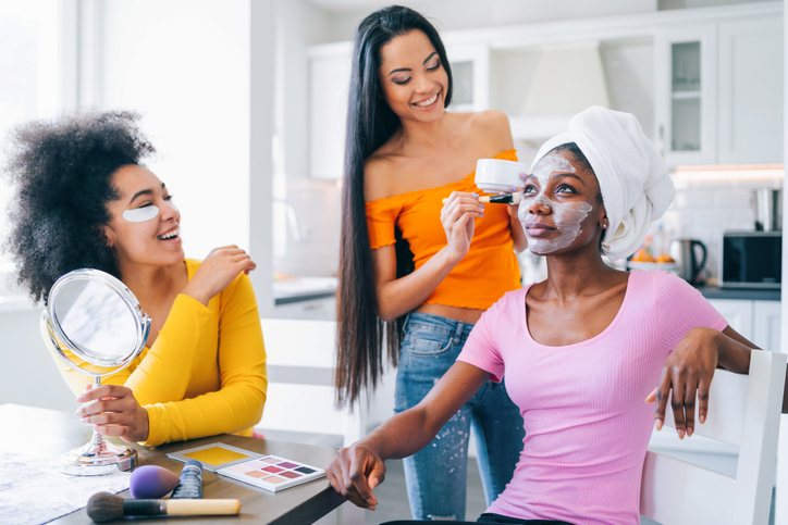 Girls taking good care of their skin and making mask