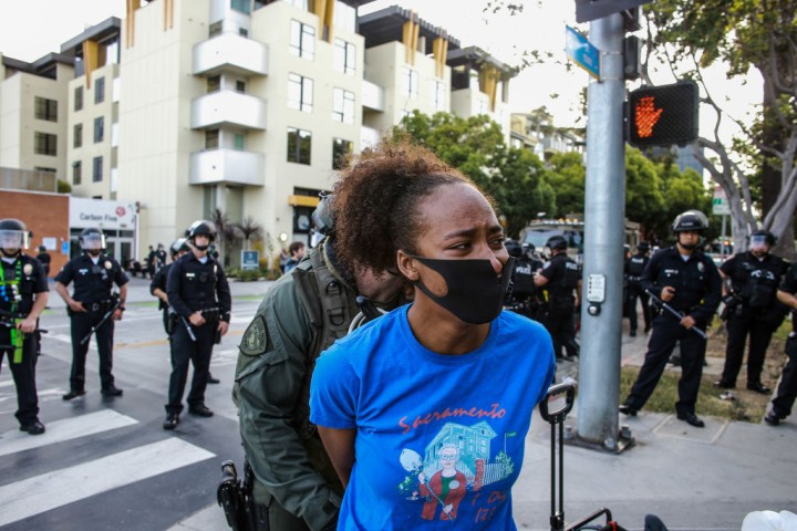 A female protester is arrested in Santa Monica during a...