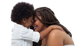 Loving son cuddling mom