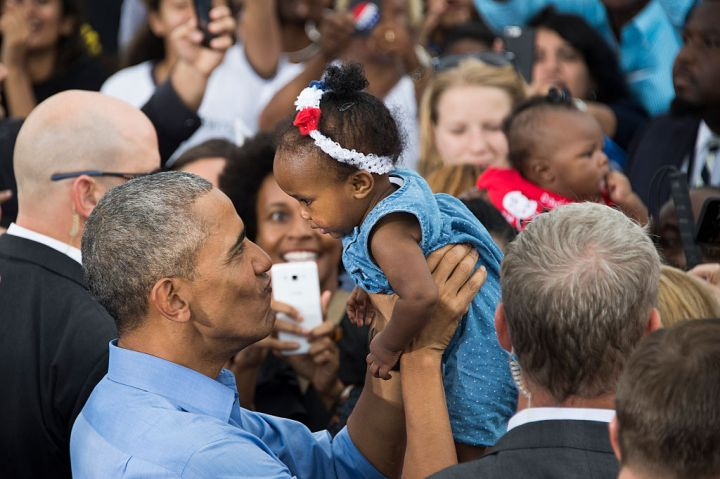 BARACK OBAMA AT THE KISSIMMEE KISSING THE BABIES