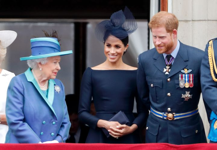QUEEN ELIZABETH II, MEGHAN MARKLE, AND HER HUSBAND PRINCE HARRY AT THE EVENTS TO MARK THE CENTENARY OF THE ROYAL AIR FORCE, 2018