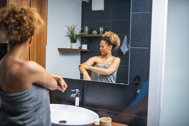 Beautiful Mixed Race African Woman Doing her routine in bathroom